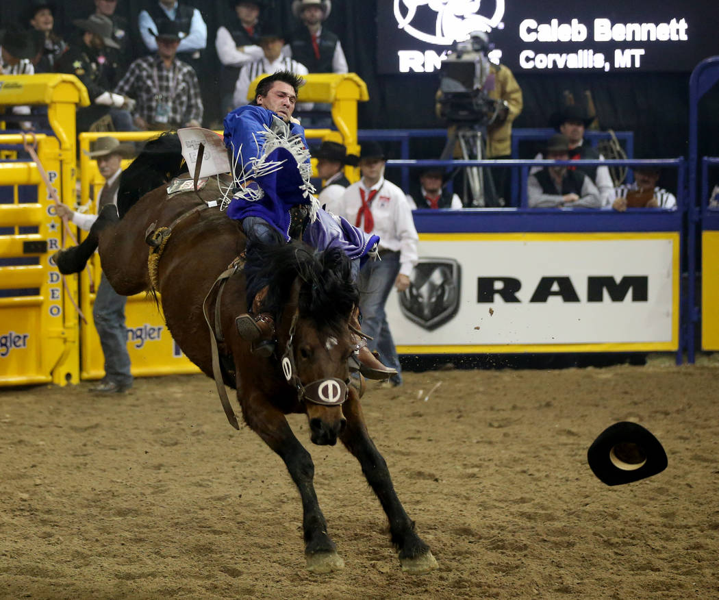 Caleb Bennett of Corvallis, Mont. rides Control Freak in Bareback Riding during the ninth go-ar ...