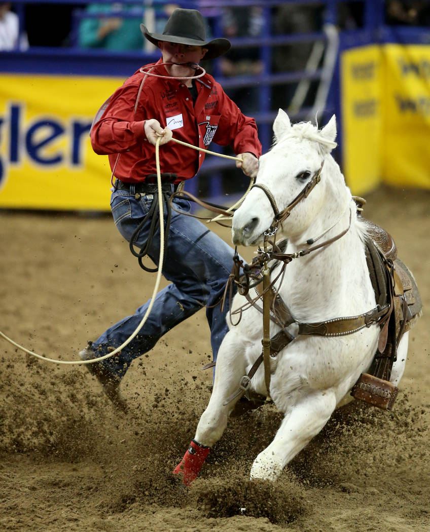 Rile y Pruitt of Gering, Neb. competes in Tie-Down Roping during the ninth go-around of the Wra ...