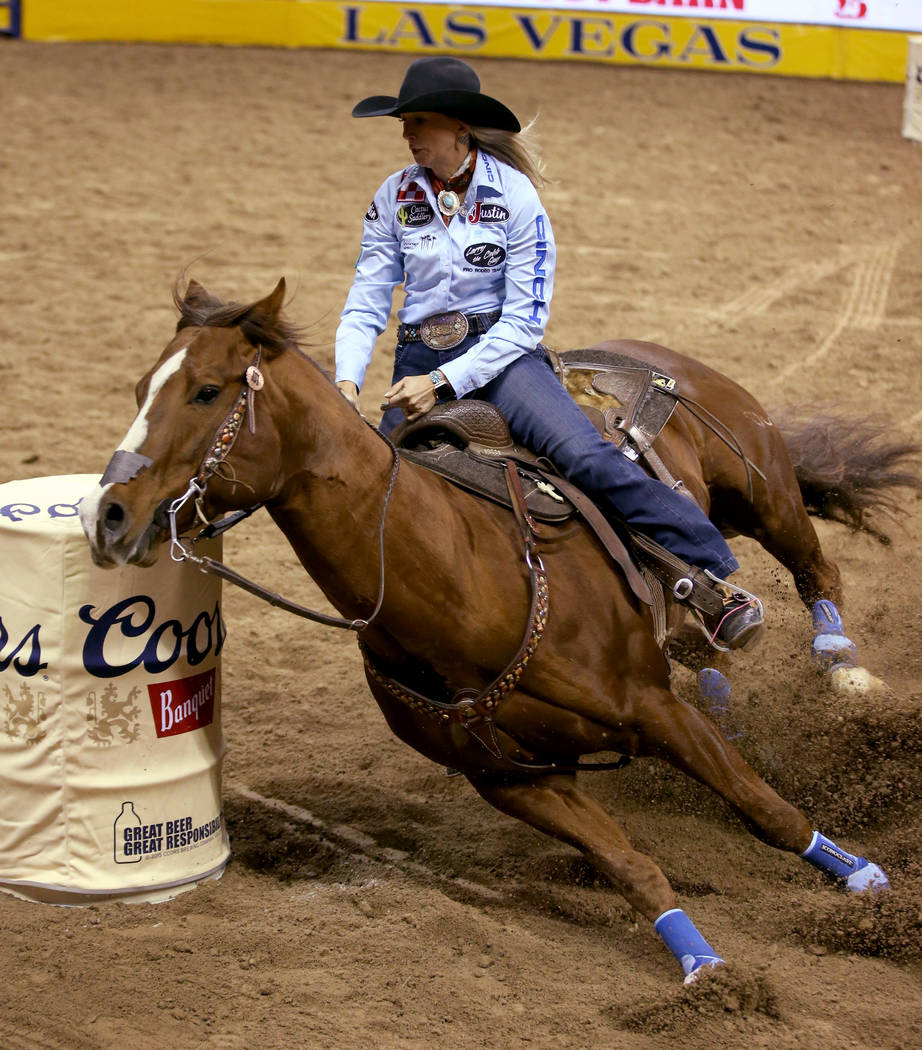 Shali ord of Lamar, Colo. competes in Barrel Racing during the ninth go-around of the Wrangler ...