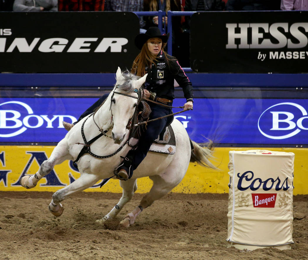 Emily Miller of Weatherford, Okla. competes in Barrel Racing during the ninth go-around of the ...