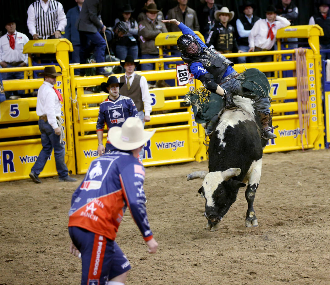 Trey Benton III of Rock Island, Texas rides Twenty to Life in the Bull Riding competition durin ...