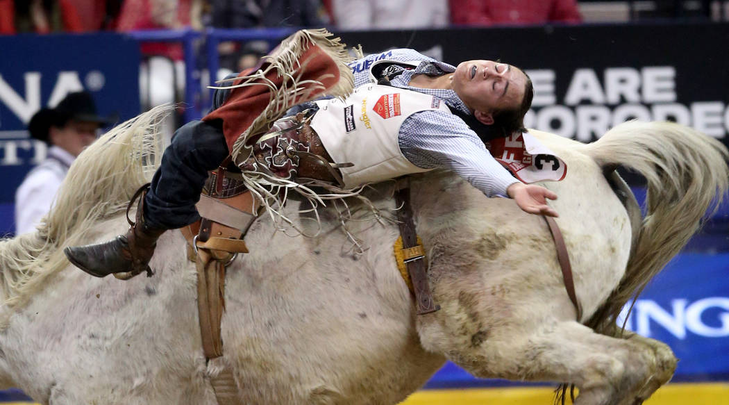 Clayton Biglow of Cleements, Calif. rides Mucho Dinero during the ninth go-around of the Wrangl ...