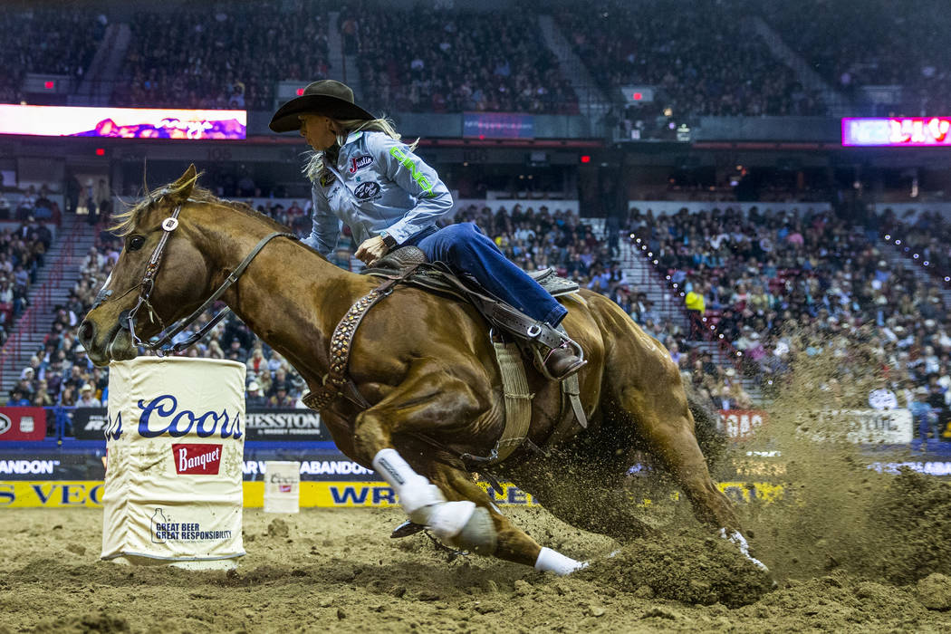 Shali Lord of Lamar, Colo., cuts around a barrel during Barrel Racing in the seventh go round o ...