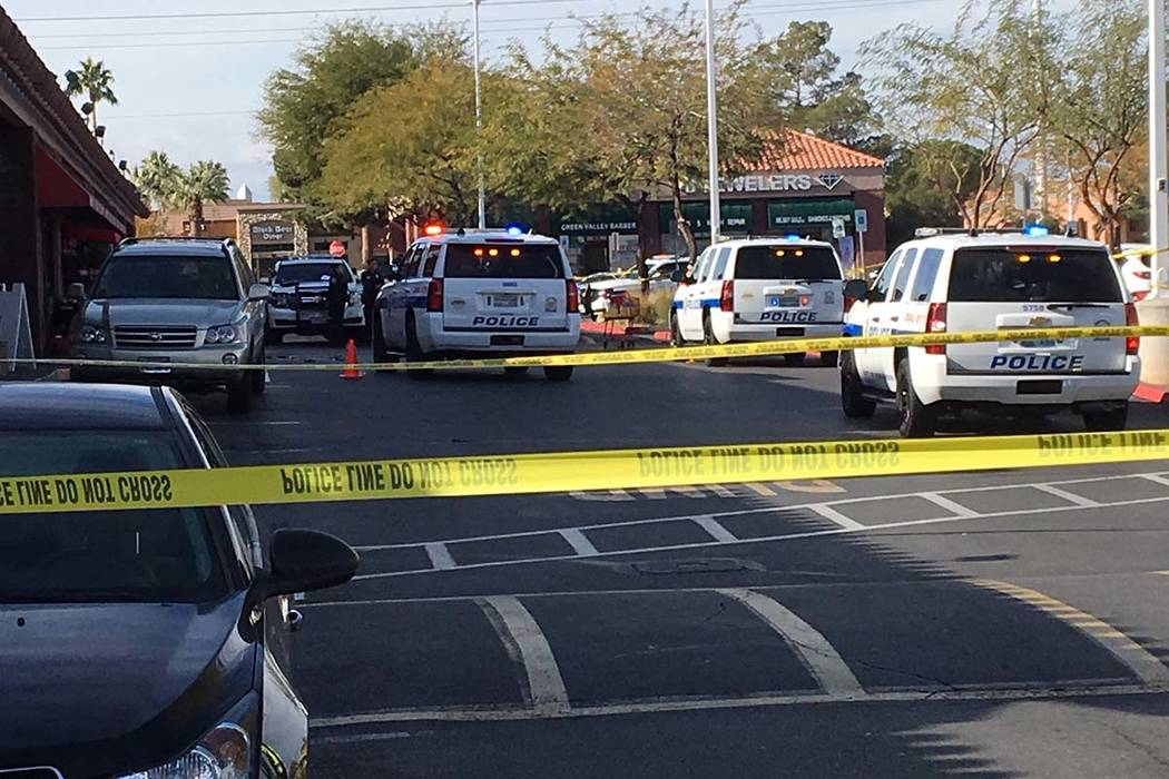 Henderson police investigate an officer-involved shooting at the Green Valley Plaza shopping ce ...