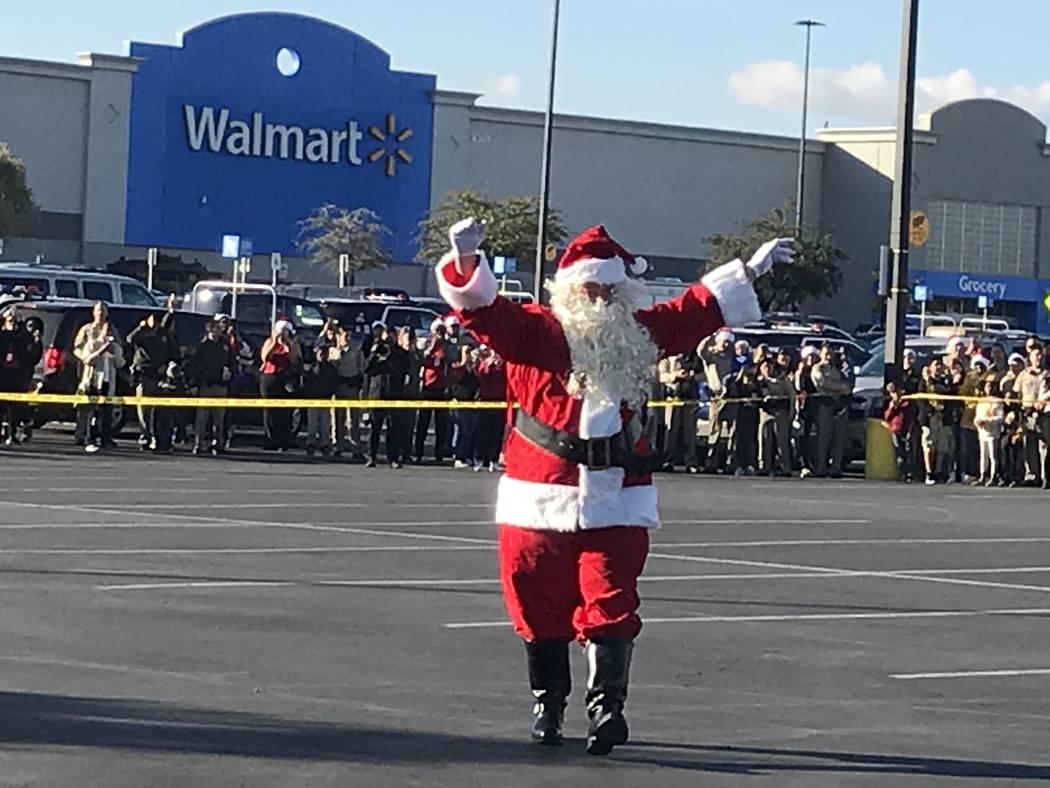 "Santa Claus waves to children during a ""Santa Cops"" event on Saturday, Dec. 14, 2019, at Walmar ..."