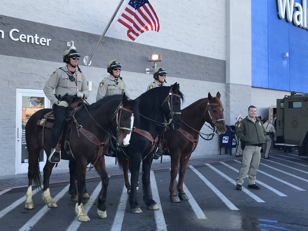 """The Metropolitan Police Department's mounted police watch the festivities during a """"Santa Cops"""" ..."""