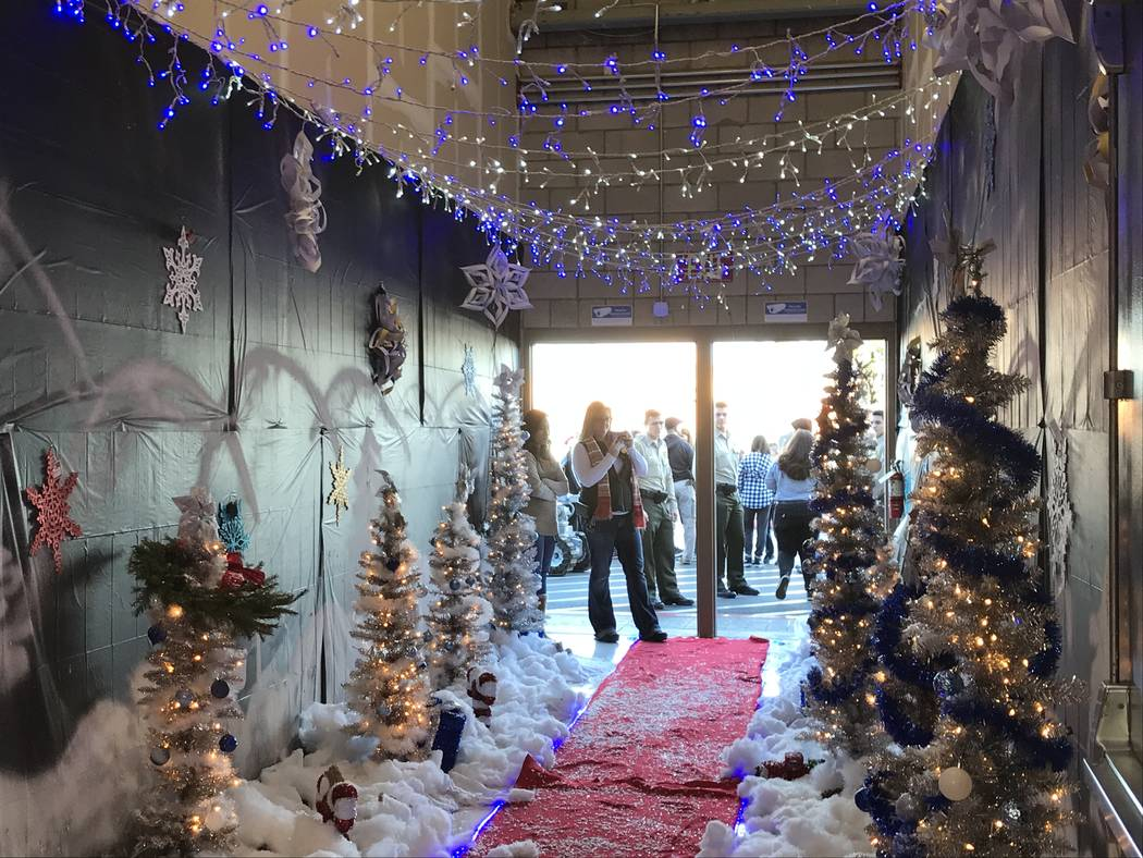 """The entryway to Walmart is decorated during a """"Santa Cops"""" event on Saturday, Dec. 14, 2019, at ..."""