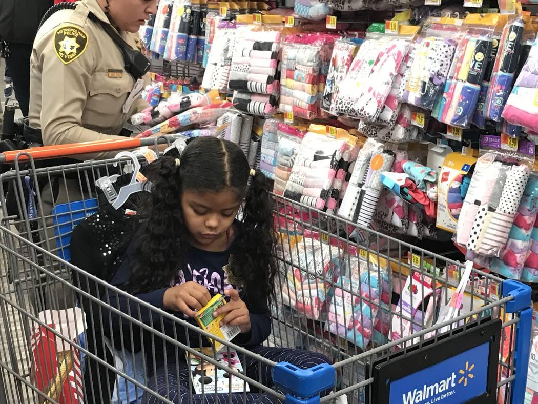"""Cathalina Correa, 6, colors during a """"Santa Cops"""" event on Saturday, Dec. 14, 2019, at Walmart ..."""