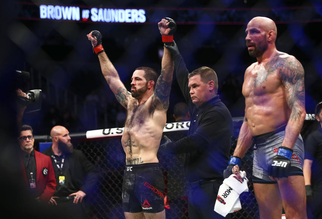 Matt Brown, left, celebrates his knockout over Ben Saunders in their welterweight bout in UFC 2 ...