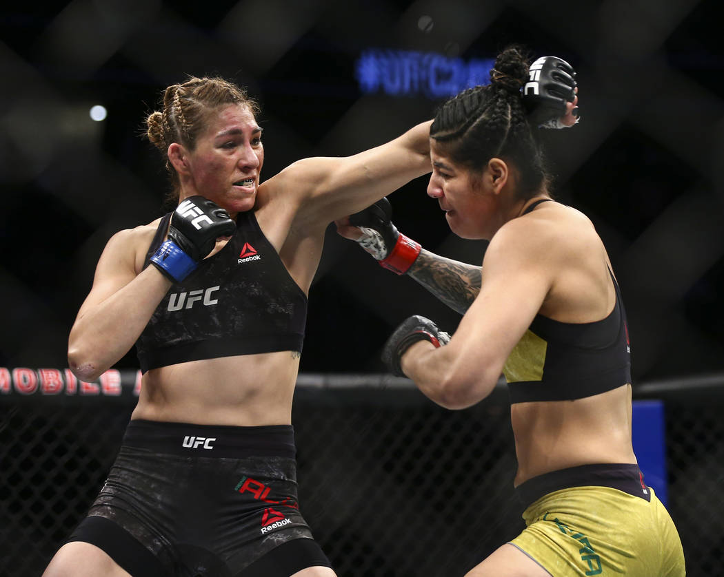 Irene Aldana, left, fights Ketlen Vieira during their bantamweight bout in UFC 245 at T-Mobile ...