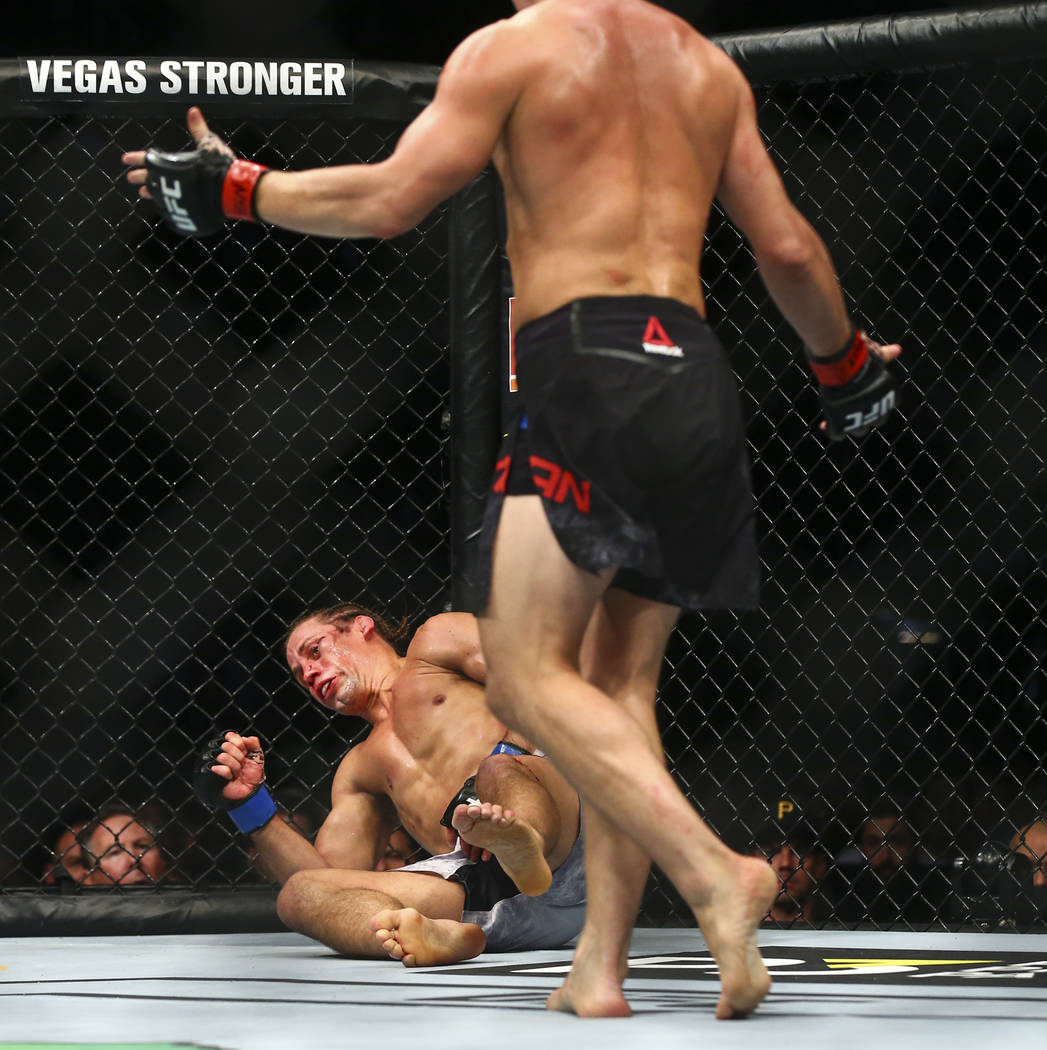 Petr Yan, right, knocks out Urijah Faber to win their bantamweight bout in UFC 245 at T-Mobile ...