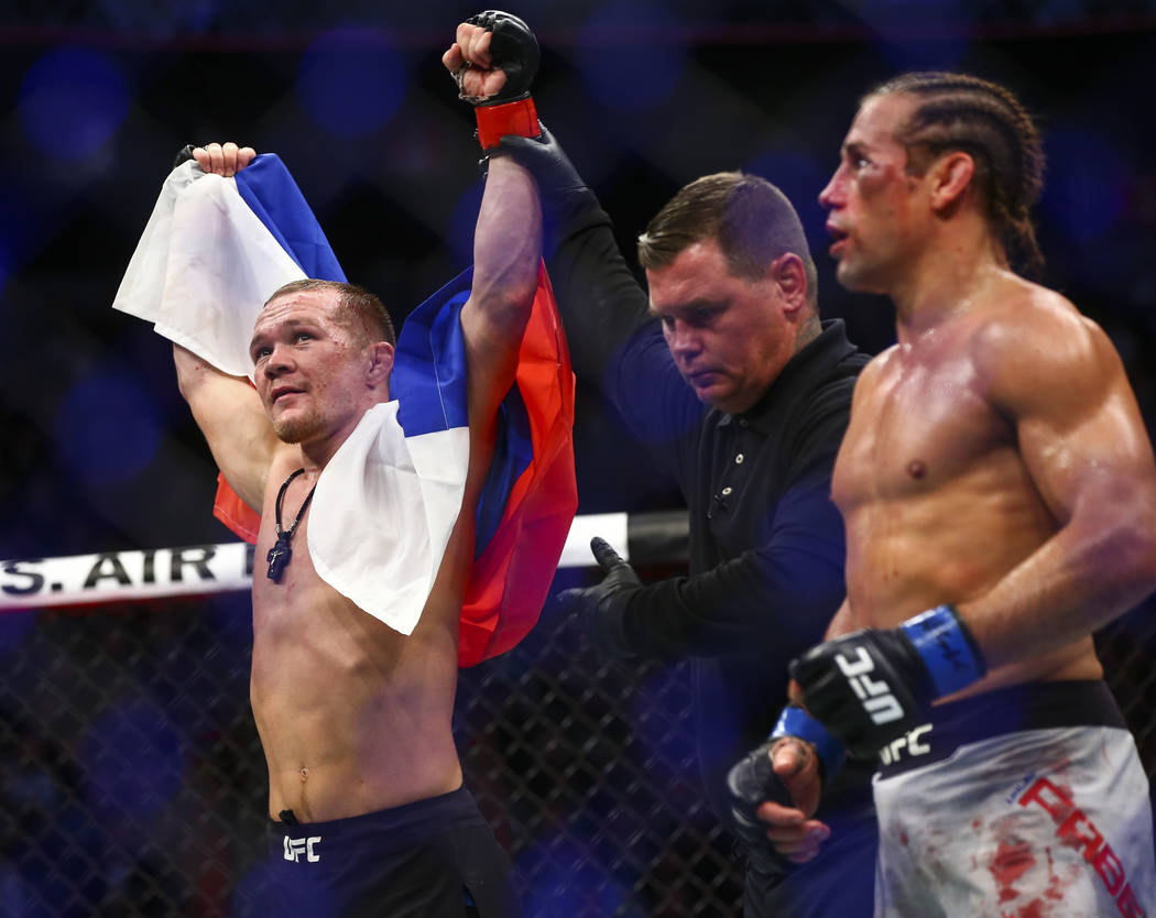 Petr Yan celebrates his knockout win against Urijah Faber in their bantamweight bout in UFC 245 ...