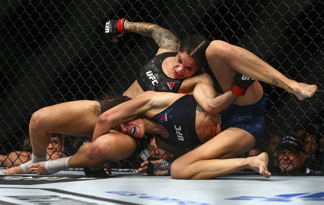 Amanda Nunes, left, fights Germaine de Randamie during their bantamweight title bout in UFC 245 ...