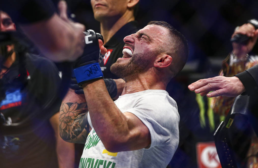 Alexander Volkanovski reacts after being declared the winner via unanimous decision over Max Ho ...