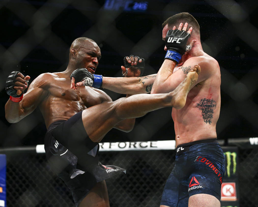 Kamaru Usman, left, fights Colby Covington during their welterweight title bout UFC 245 at T-Mo ...
