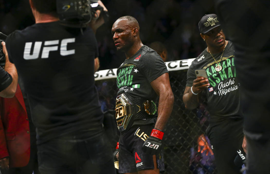 Kamaru Usman looks on after defeating Colby Covington via technical knockout in their welterwei ...