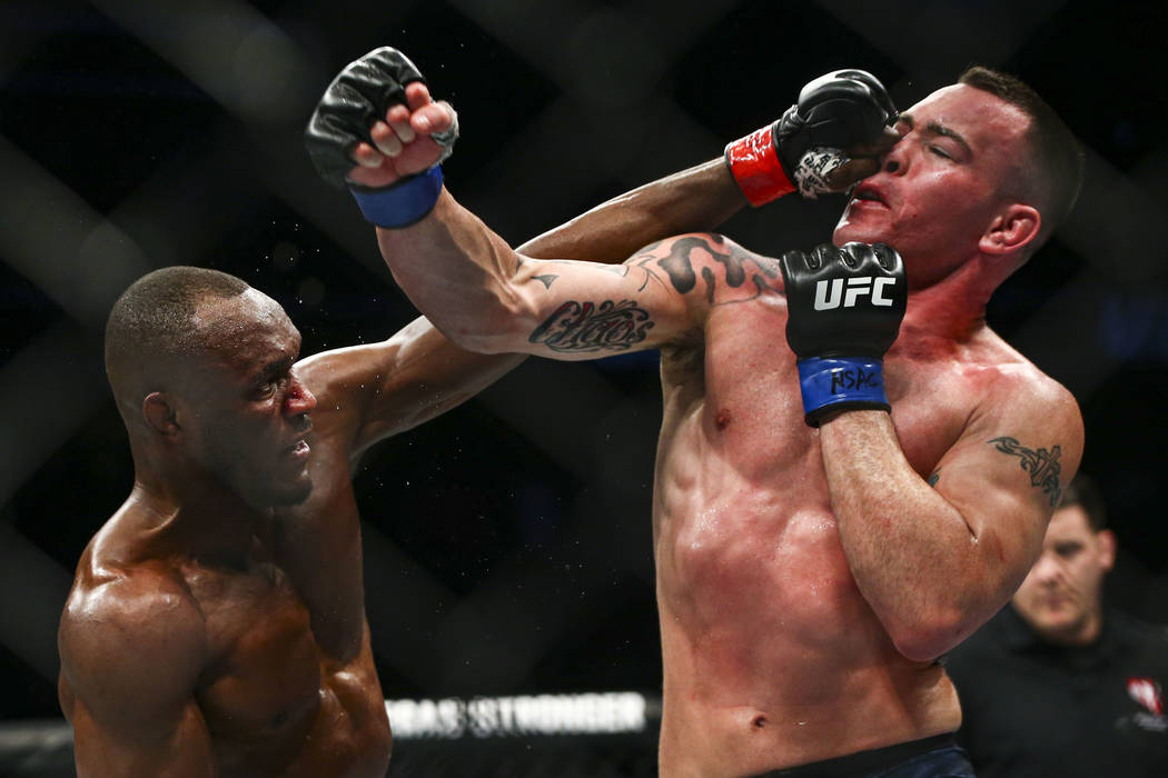 Kamaru Usman, left, fights Colby Covington during their welterweight title bout in UFC 245 at T ...