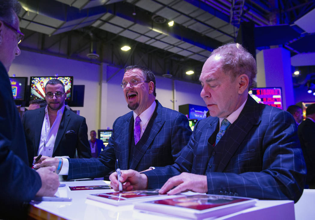 Penn and Teller sign autographs at the Everi booth at the 18th annual Global Gaming Expo at San ...