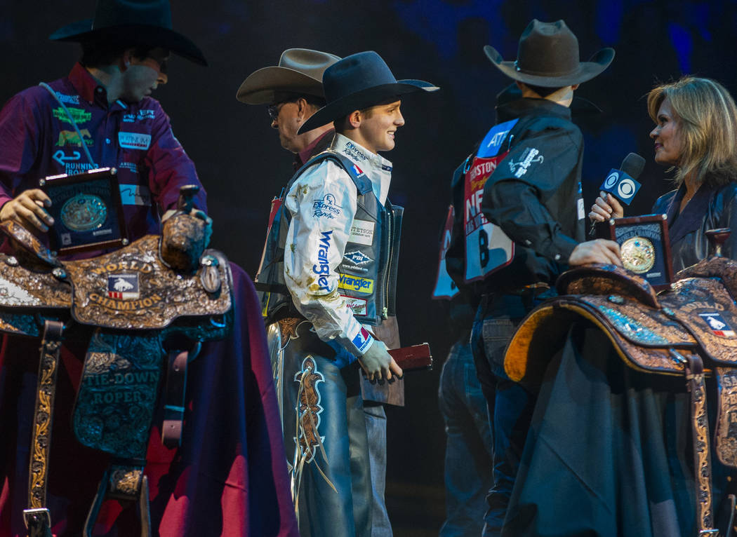 Stetson Wright of Milford, Utah, center, is named the All-Around World Champion following the t ...