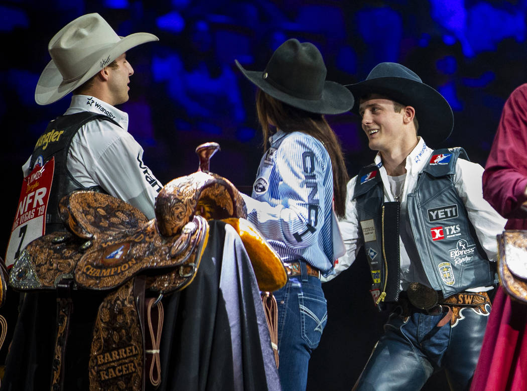 Stetson Wright of Milford, Utah, right, named the All-Around World Champion congratulates All-A ...
