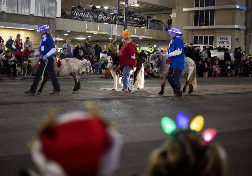 Ponies are part of the parade at Henderson's annual WinterFest on Saturday, Dec. 14, 2019, in H ...