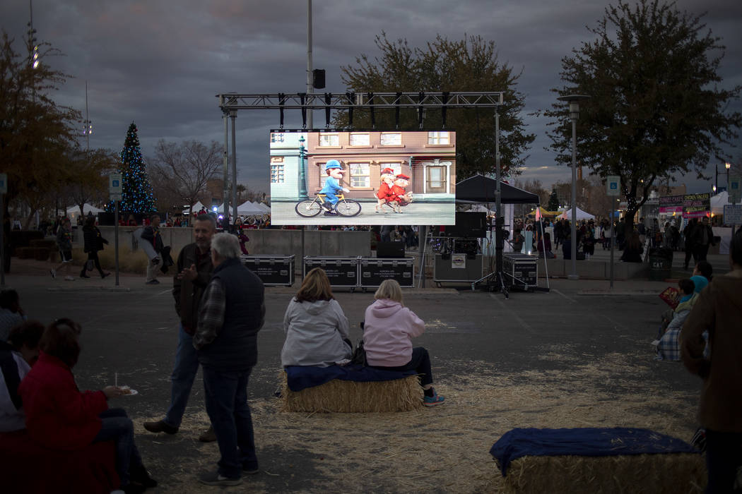 A screen plays classic holiday movies at Henderson's annual WinterFest on Saturday, Dec. 14, 20 ...