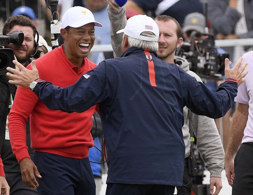 U.S. team player and captain Tiger Woods, left, celebrates with vice captain Fred Couples after ...