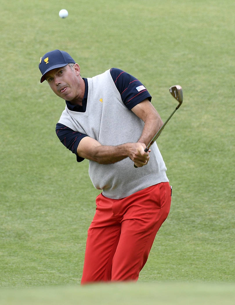 U.S. team player Matt Kuchar chips to the green on the 11th hole in their foursome match during ...