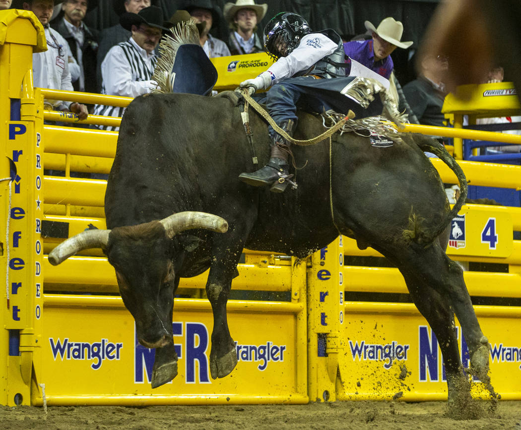 Stetson Wright of Milford, Utah, briefly rides Pickup Man in Bull Riding during the tenth go ro ...