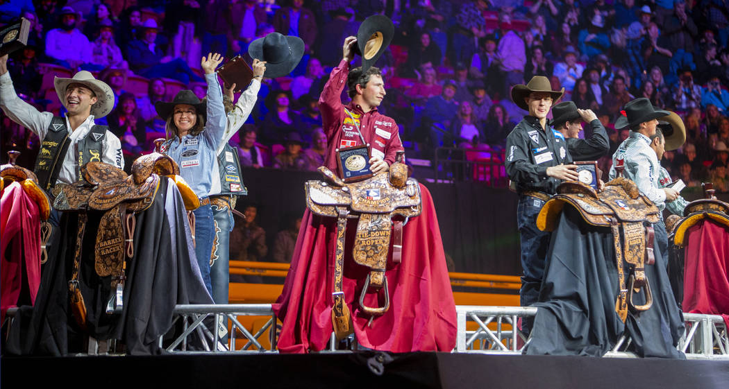 All-Around World Champion Stetson Wright of Milford, Utah, center left, stands with All-Around ...