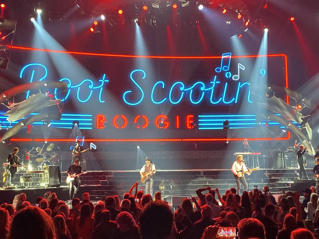 "Kix Brooks and Ronnie Dunn perform ""Boot Scootin' Boogie"" during the Reba and Brooks & Dunn sho ..."