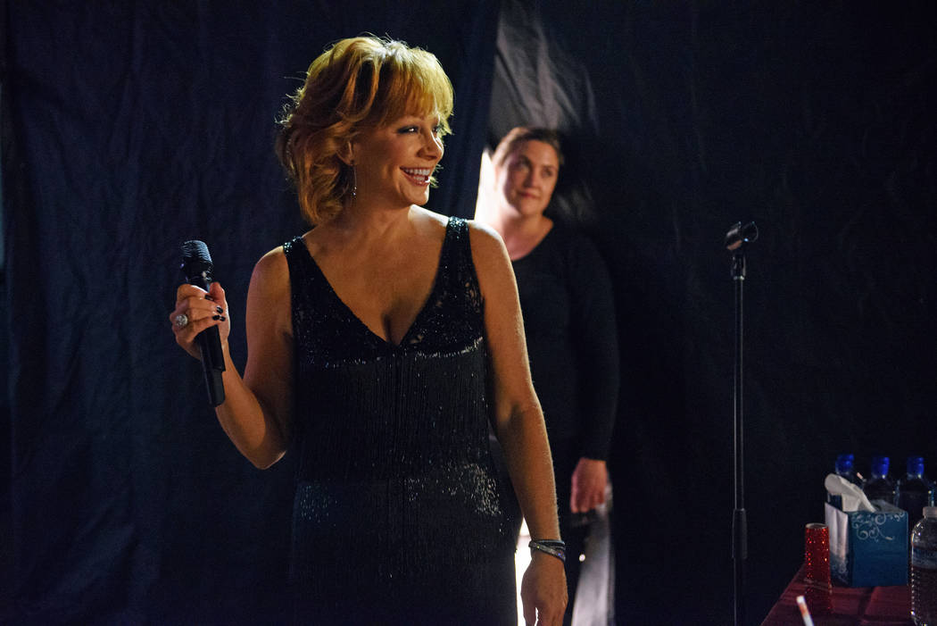 """Reba McEntire sang """"The Star Spangled Banner"""" during the Reba and Brooks & Dunn show at the Col ..."""
