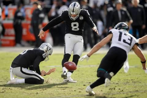 Oakland Raiders kicker Daniel Carlson (8) kicks a field goal as Jacksonville Jaguars wide recei ...