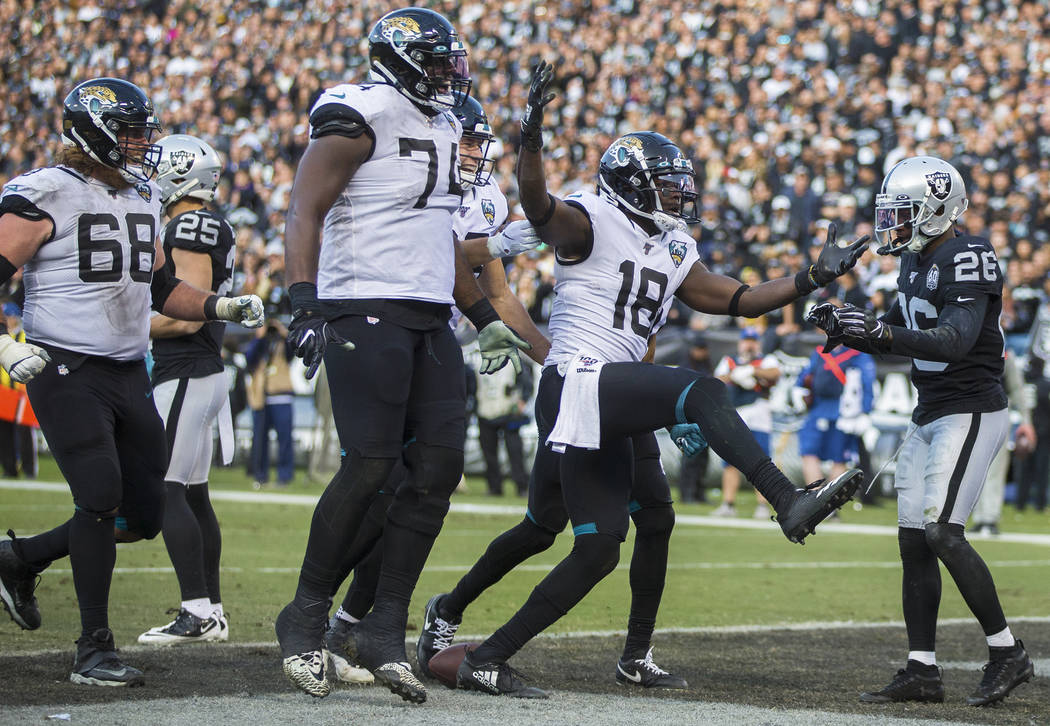 Jacksonville Jaguars wide receiver Chris Conley (18) celebrates with teammates Jacksonville Jag ...