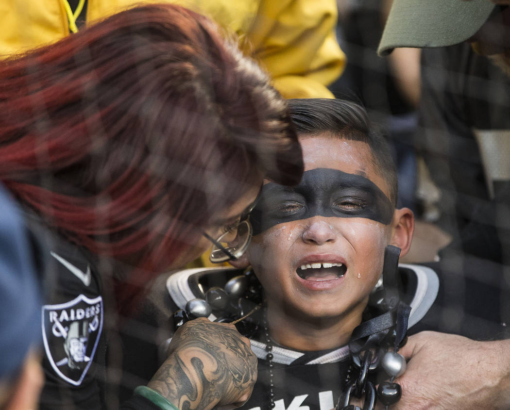 A Raider fan cries after Oakland lost to the Jacksonville Jaguars 20-16 during an NFL football ...