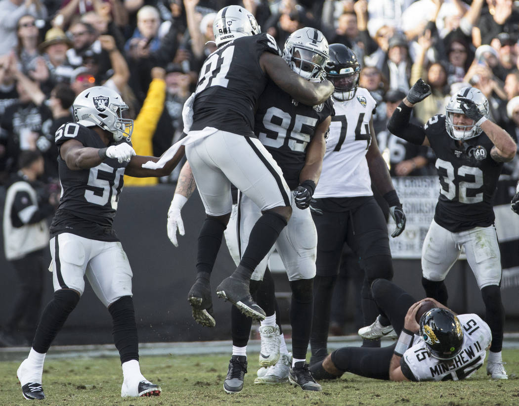 Oakland Raiders defensive end Dion Jordan (95) celebrates a defensive stop with Oakland Raiders ...