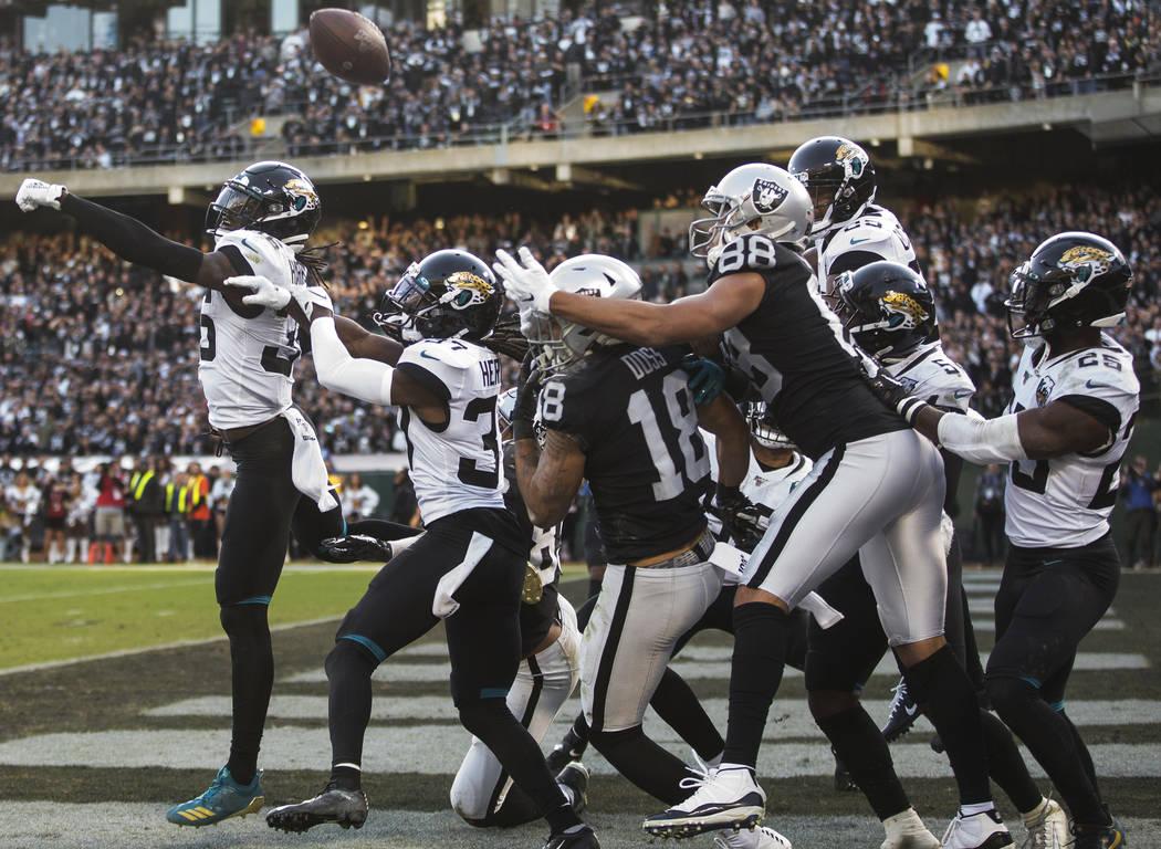 Jacksonville Jaguars strong safety Ronnie Harrison (36) and Jacksonville Jaguars cornerback Tre ...