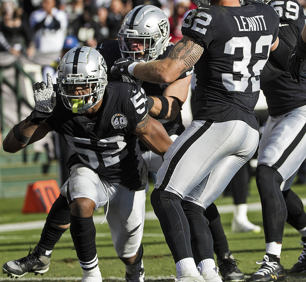 Oakland Raiders middle linebacker Marquel Lee (52) celebrates after making a defensive stop wit ...