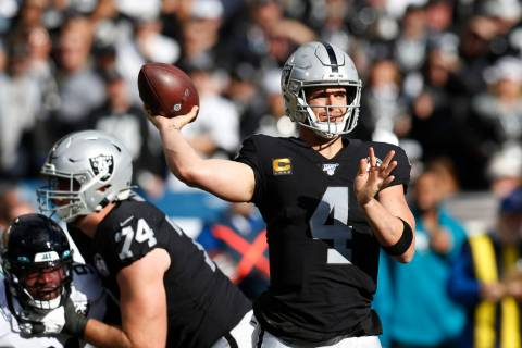 Oakland Raiders quarterback Derek Carr during the first half of an NFL football game against th ...