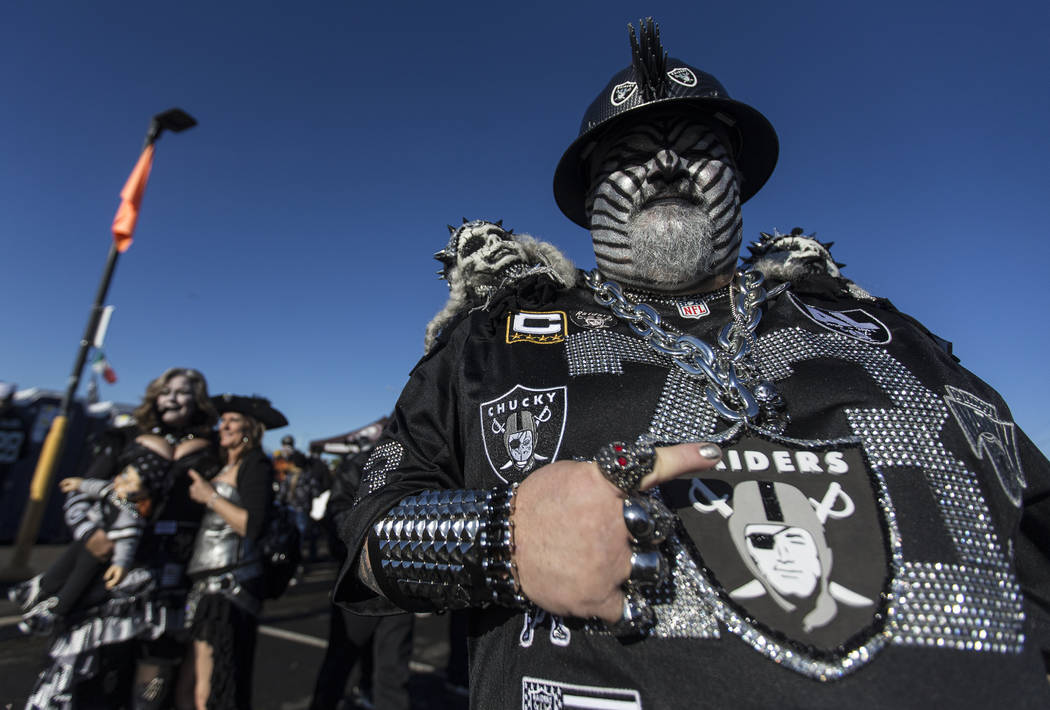 """""""The Hollywood Raider,"""" right, at a tailgate outside the Oakland Coliseum before the ..."""