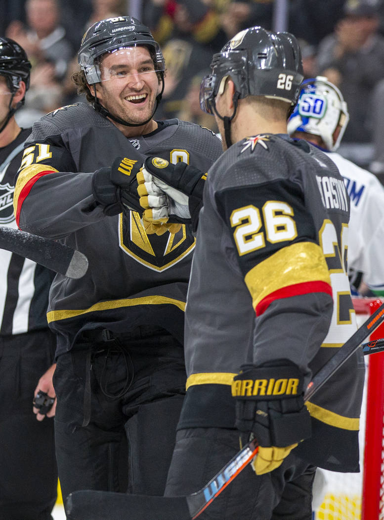 Vegas Golden Knights right wing Mark Stone (61, left) celebrates a goal with Vegas Golden Knigh ...