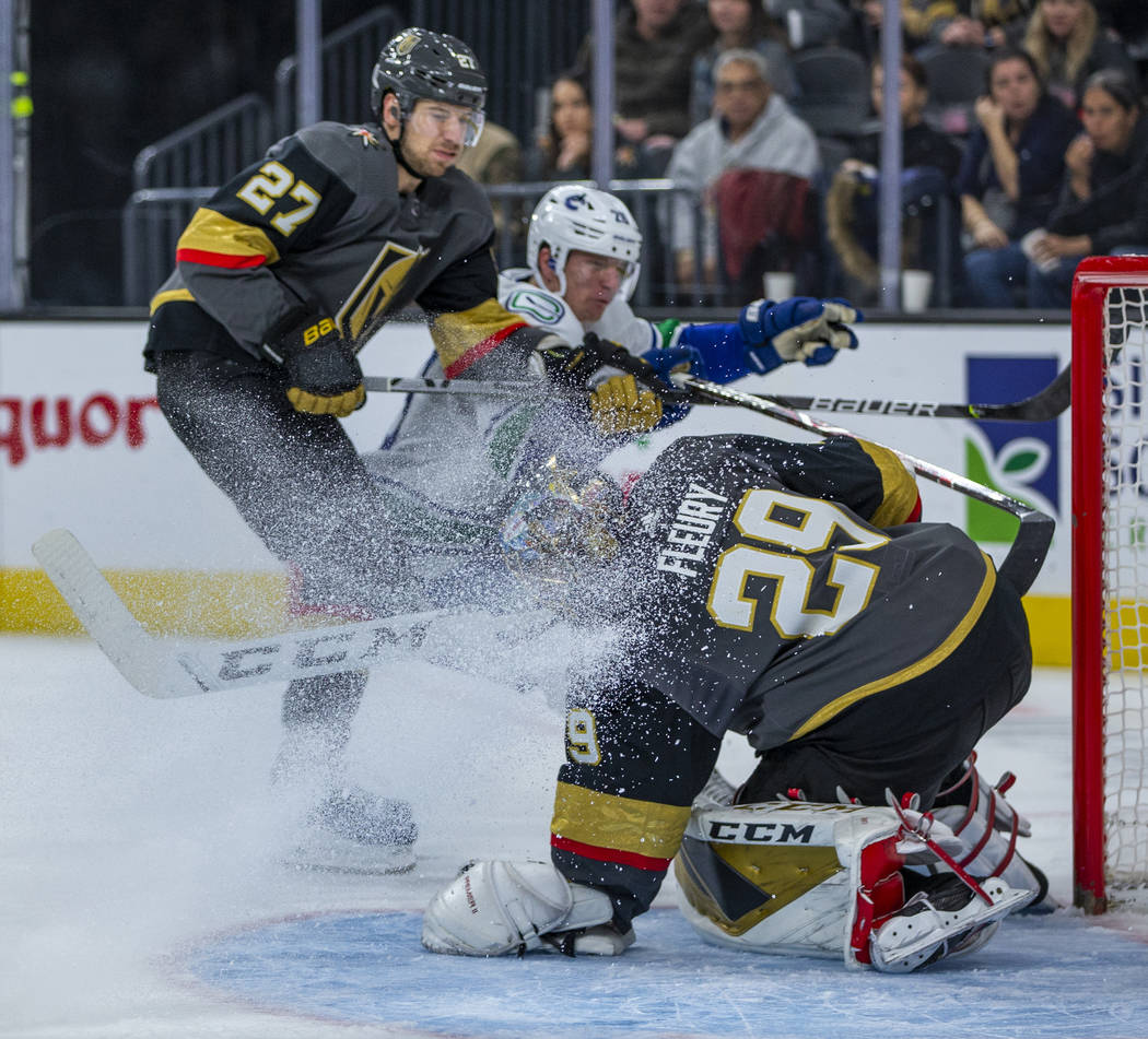 Vegas Golden Knights goaltender Marc-Andre Fleury (29) traps another shot on goal while getting ...