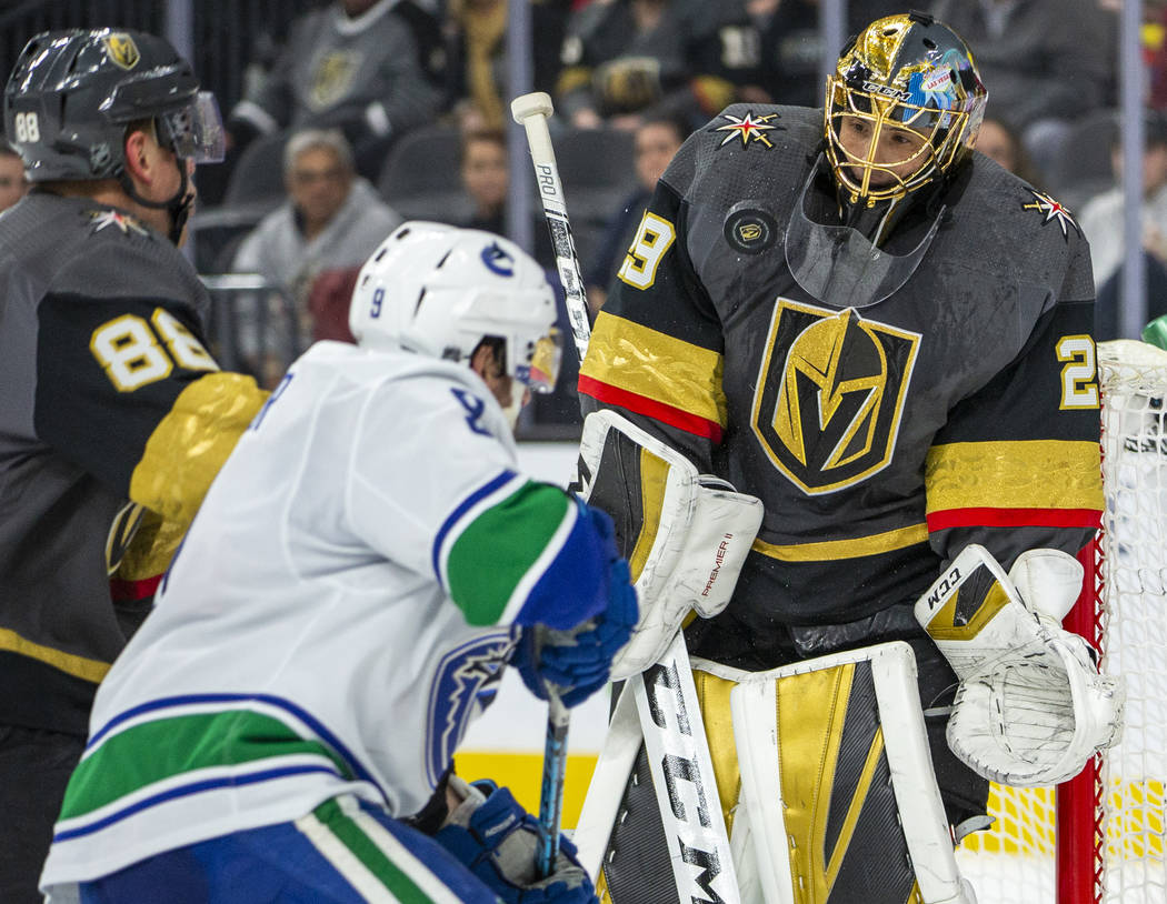 Vegas Golden Knights goaltender Marc-Andre Fleury (29, right) deflects another puck off his che ...