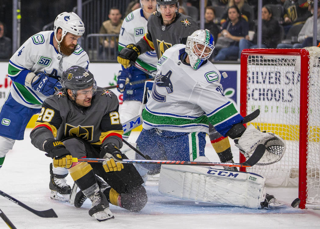 Vegas Golden Knights left wing William Carrier (28) takes a shot at the net on Vancouver Canuck ...