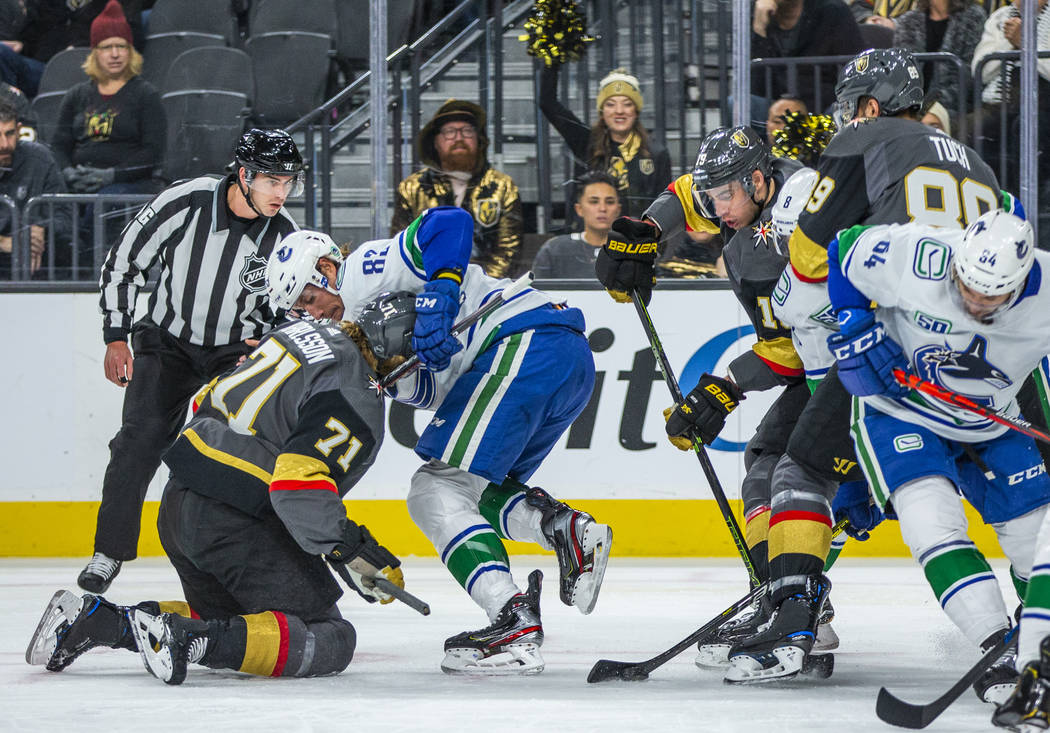 Vegas Golden Knights center William Karlsson (71, left) takes a stick under the chin from Vanco ...