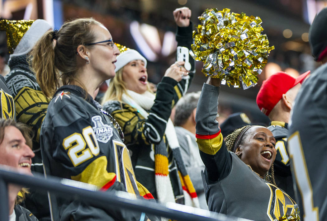 Vegas Golden Knights fans celebrate another goal over the Vancouver Canucks during the first p ...
