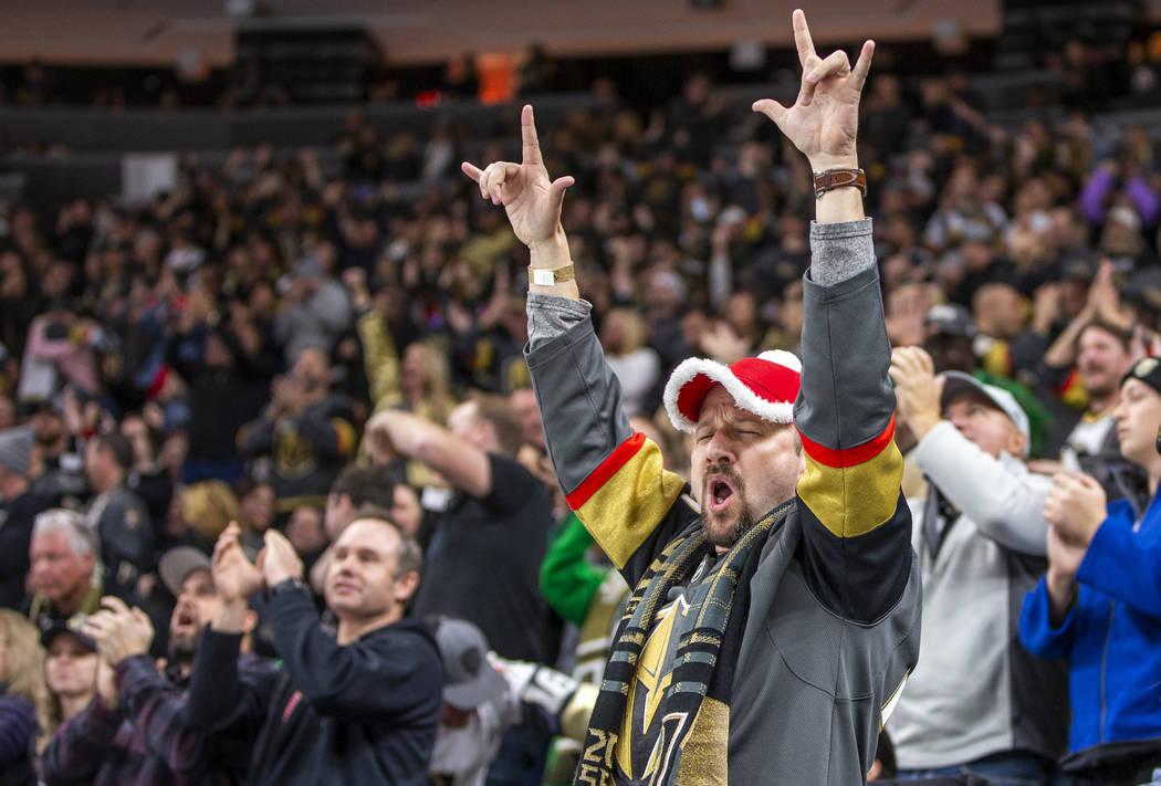 Vegas Golden Knights fans celebrate another goal over the Vancouver Canucks during the second ...