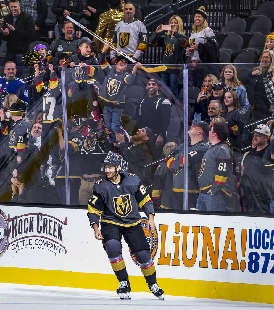 A lucky fan gets a stick from Vegas Golden Knights left wing Max Pacioretty (67) after 2 goals ...