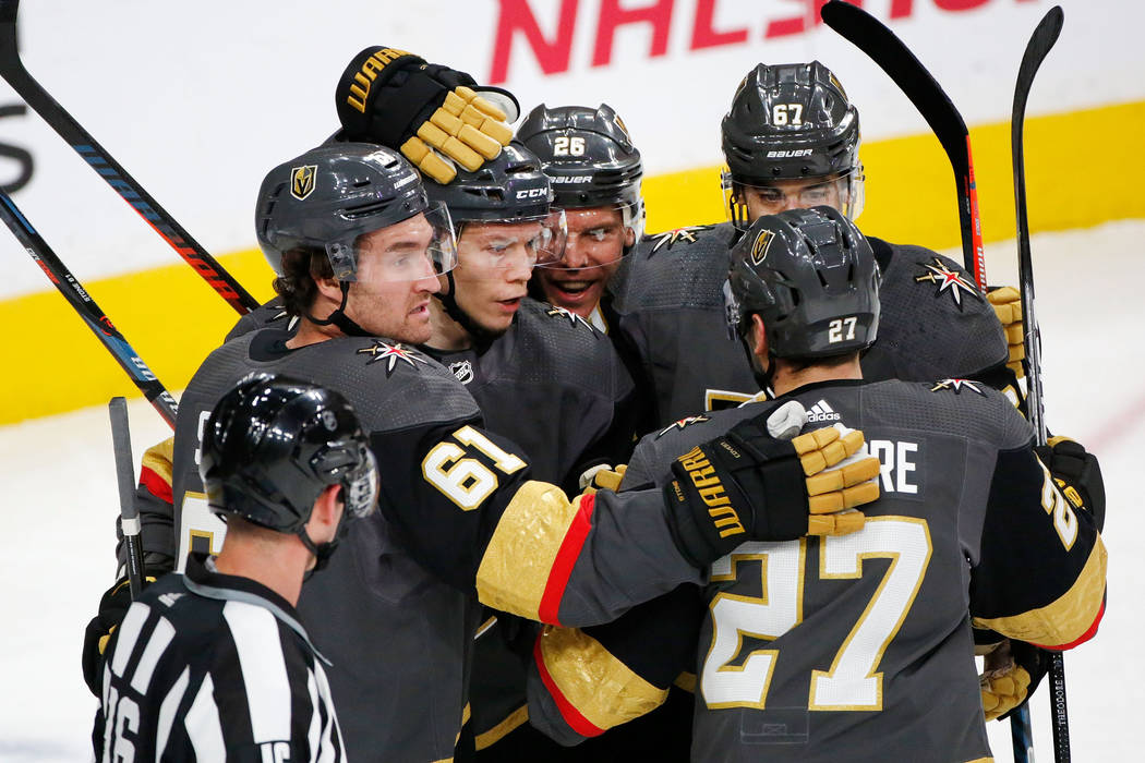 Vegas Golden Knights left wing Valentin Zykov (7), second from left, celebrates with his teamma ...