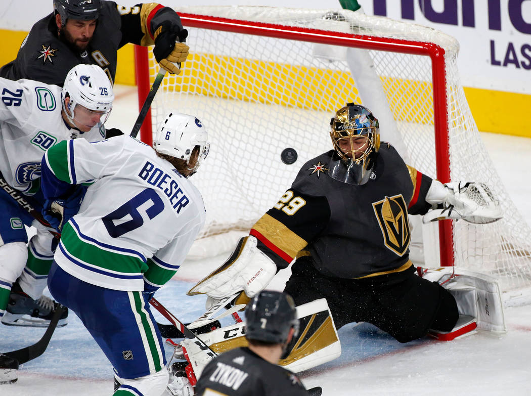 Vegas Golden Knights goaltender Marc-Andre Fleury (29) cannot stop a puck shot by Vancouver Can ...